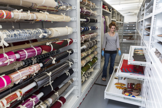 Assistant Curator Krista Barry'15 in the textile storage area of the Logan Museum of Anthropolo...