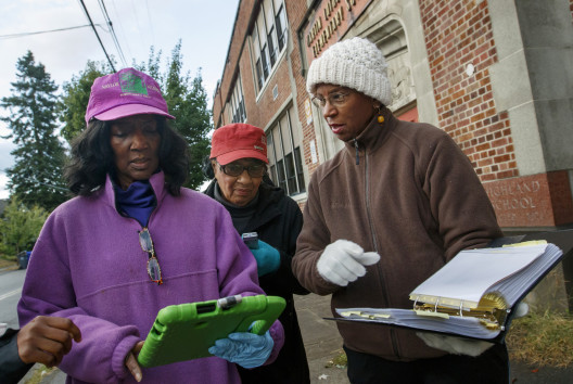 From left: Vickie Naylor, Bernadine Clay, and Donna Maxey review their walking route as they part...