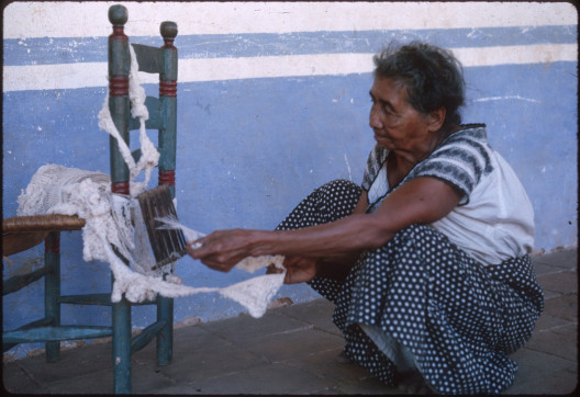 Odona Valentín uses a special loom to weave fringe. Bristol took this photo in Oaxaca in 1966.