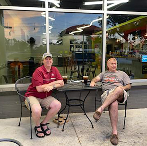 SAE fraternity brothers P.G. Kraemer III?88, left, and Michael Newman?88 met in Tallahassee, Fla....