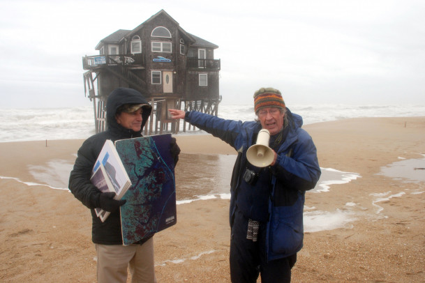 In 2014, Riggs, right, and a colleague explain nor'easter storm dynamics and barrier island reces...