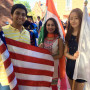 One of Mustafa Quadir's many happy memories includes serving as an international student flag bearer at Beloit's 2016 Convocation. Shown from left are Mustafa, Yashodhara Kundra, and YJ Na. — Submitted by Mustafa Quadir