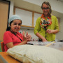 Student Mati Schliem-Guzman works with Education Program Specialist Bri Hansen to sort hard and soft items to put into a pillow to be donated to the Humane Society. Hansen said the exercise helps Schliem-Guzman overcome her tactile defensiveness.