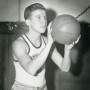 John Erickson'49 playing basketball as a student.