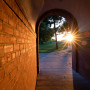 A beautiful sunset glowing through the arched walkway in Morse-Ingersoll hall.